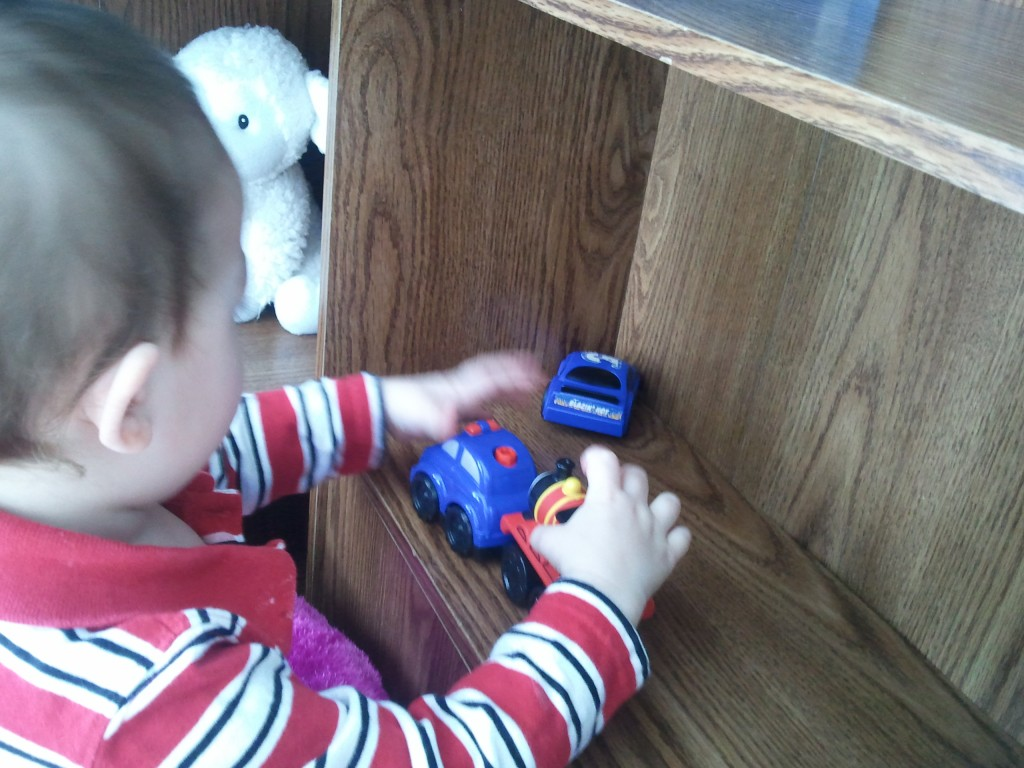 Kyler playing with cars