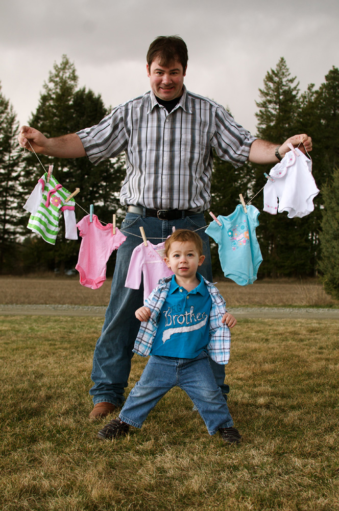 Daddy and Kyler, hanging out the laundry